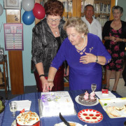 Eve & Glenys cutting the 80th anniversary cake