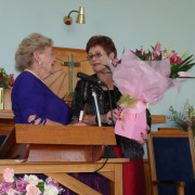Glenys Lindsay presenting Eve Higgins with Flowers at the Church's 80th Anniversary